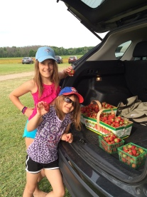"The girls showing off their ""biggest pick"" and our bounty."