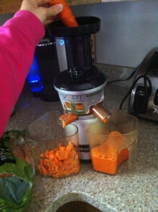 Juicing carrots, ginger and lemon.
